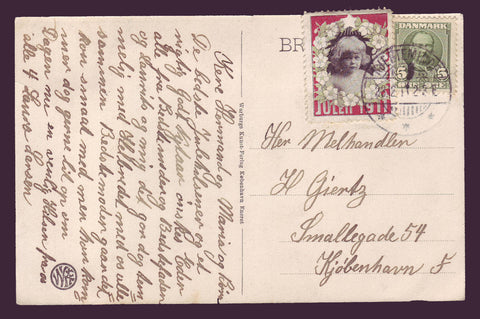 DE8008.1 Denmark 1911 Christmas seal tied to postcard.