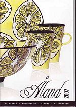 Aland Year Set cover showing handcrafted dinnerware.
