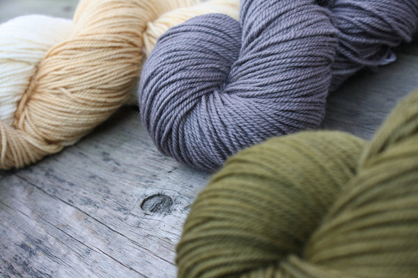 Naturally Dyed Yarn in olive, grey, and caramel