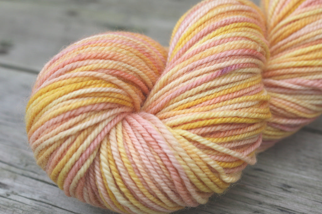 Woodland Merino Wool in Grapefruit Sorbet, yellow pink and purple hand painted yarn