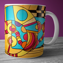 Modern art coffee mug and tea cup with bright orange geometric art.