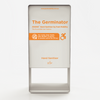 "A close up image of The Germinator, with orange text that reads ""Zoono Hand Sanitiser by Push Mobility"""