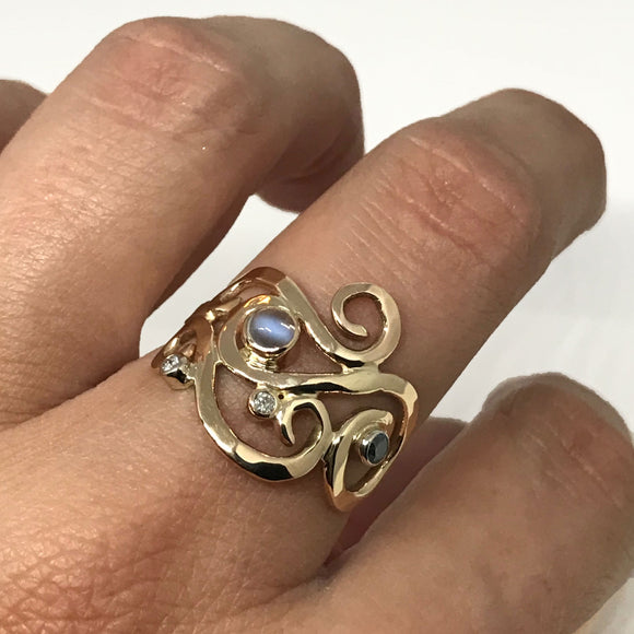 Gold Swirl Moonstone Ring with Blue and White Diamonds