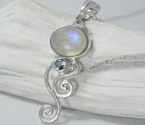 Moonstone Oval Swirl Pendant with Sky Blue Topaz