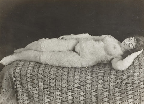 Ancient sex doll lying on bed