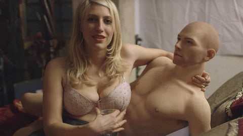 Female holding male sex doll