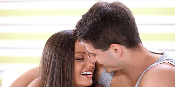Happy female and male couple having sex