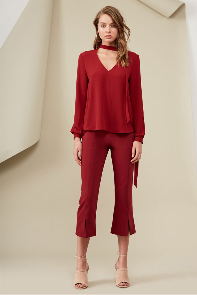 model wearing red long sleeve blouse