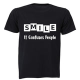 SMILE - it confuses people! - Adults - T-Shirt