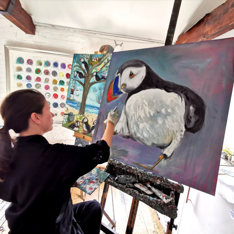 Dawn Painting one of her Puffins