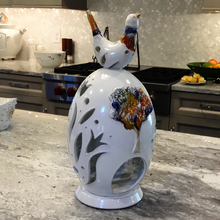 "Tall hand-made ceramic ""Egg"" with bird adornment."