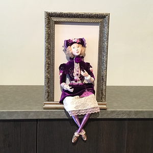 Framed Doll with Purple Dress