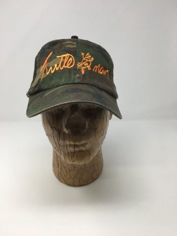 CAMOUFLAGE HAT WITH ORANGE TRADEMARK