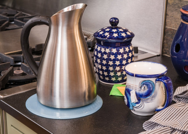 Protect counter top from hot water tea kettle with silicone trivet that matches tea set.