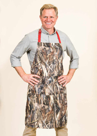 Man about to grill with his camo apron from aprons by jem