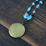 blue sky day :: locket with blue glass beads