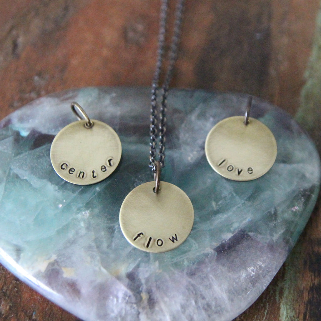 brass circle mantra necklaces