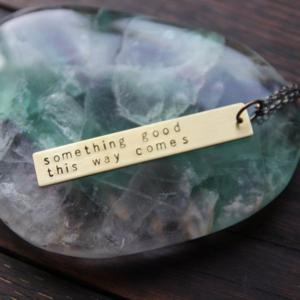 something good this way comes :: brass bar mantra necklace