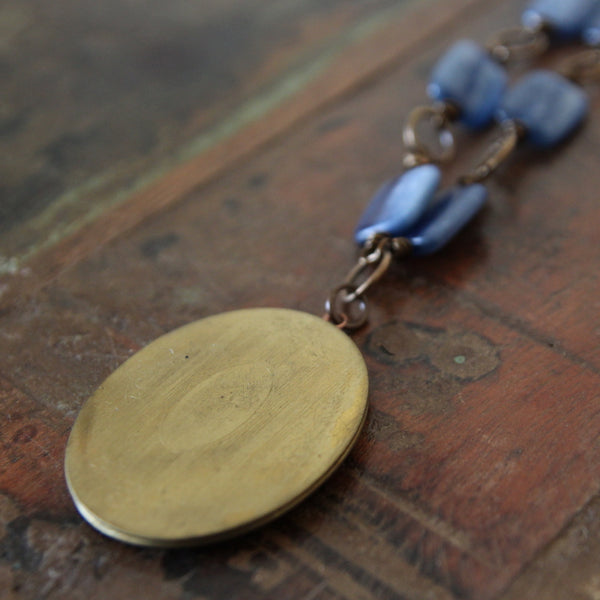 courage to speak your truth :: locket with kyanite