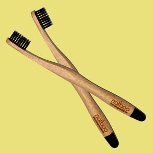 2 Natboo Toothbrushes. Black + (another color)