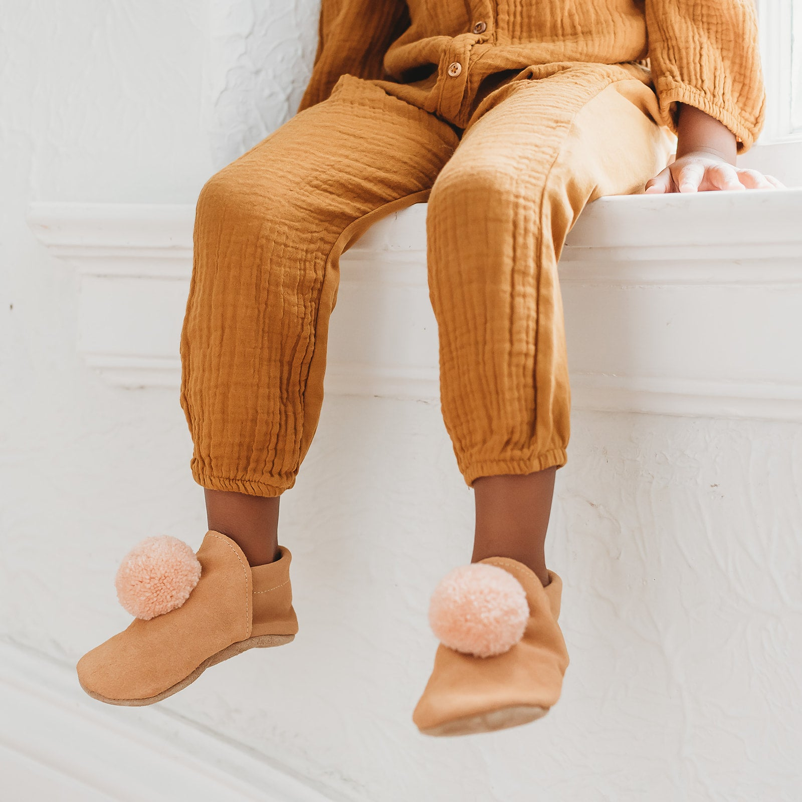 suede pompom shoes - rust