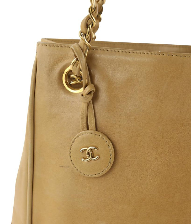 Pre-loved authentic Chanel Shopping Tote Beige Leather sale at jebwa