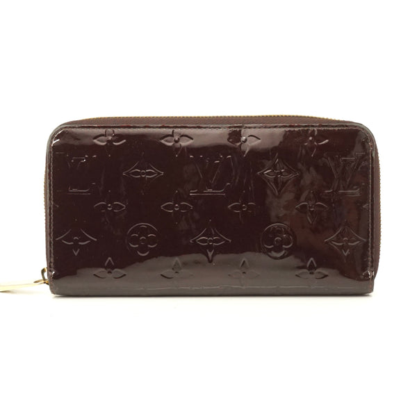 Pre-loved authentic Louis Vuitton Zippy Wallet Amarante sale at jebwa