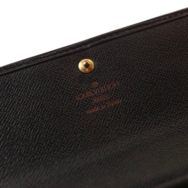 Pre-loved authentic Louis Vuitton Porte Tresor Trifold sale at jebwa.