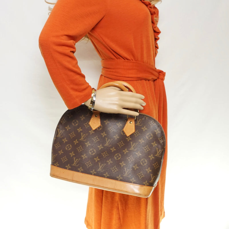 Pre-loved authentic Louis Vuitton Alma Hand Bag Brown sale at jebwa.