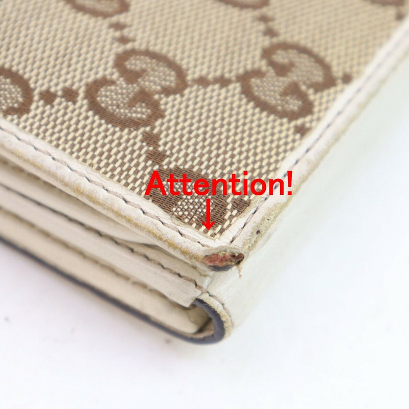 Pre-loved authentic Gucci Gg Heart Wallet Beige Canvas sale at jebwa