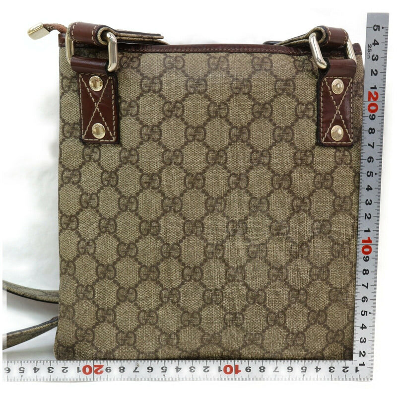 Pre-loved authentic Gucci Gg Coated Canvas Crossbody sale at jebwa