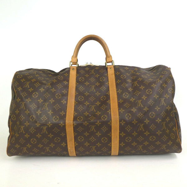 Pre-loved authentic Louis Vuitton Keepall Bandouliere sale at jebwa