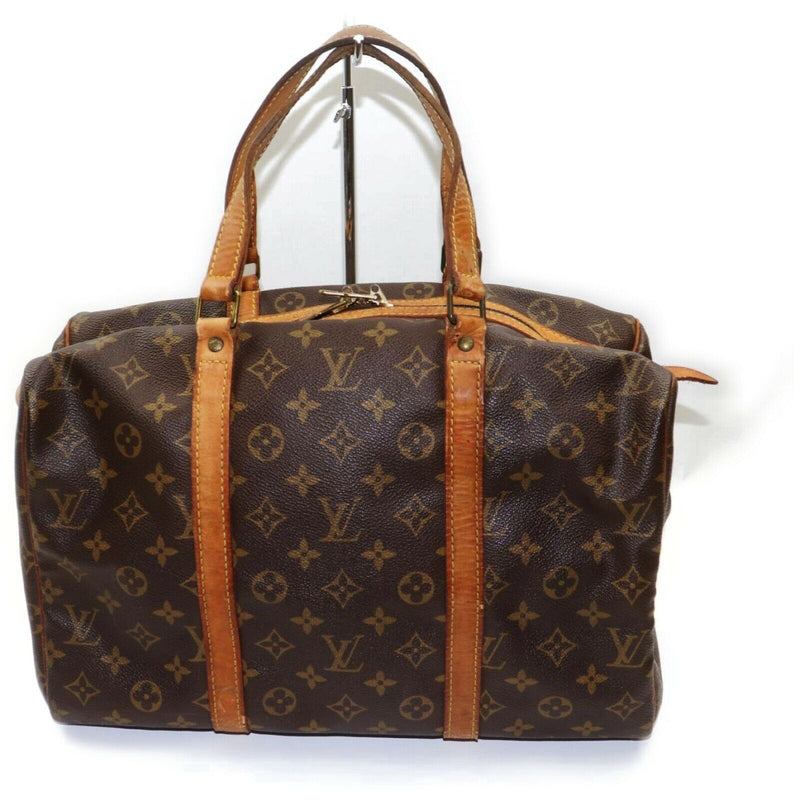 Pre-loved authentic Louis Vuitton Sac Souple 35 Travel sale at jebwa