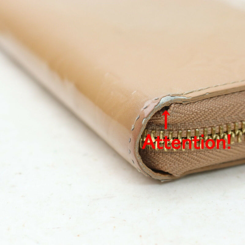 Pre-loved authentic Louis Vuitton Zippy Wallet Beige sale at jebwa