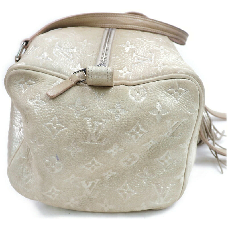 Pre-loved authentic Louis Vuitton Comete Shimmer sale at jebwa