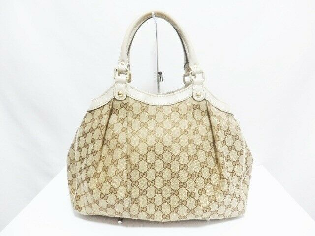 Pre-loved authentic Gucci Gg Sukey Beige Brown White sale at jebwa
