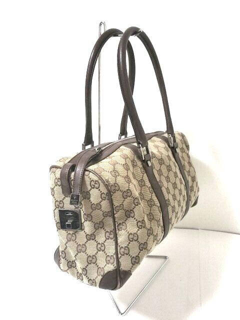 Pre-loved authentic Gucci Gg Beige Dark Brown Jacquard sale at jebwa