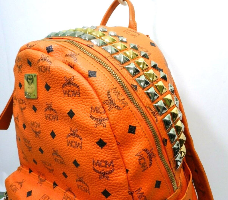 Pre-loved authentic Mcm Stark Studded Unisex Orange sale at jebwa