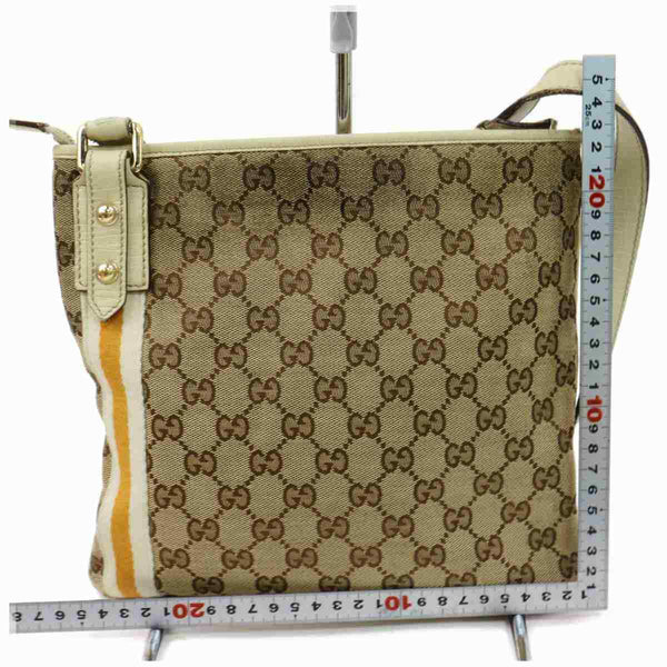 Pre-loved authentic Gucci Crossbody Bag White Canvas sale at jebwa