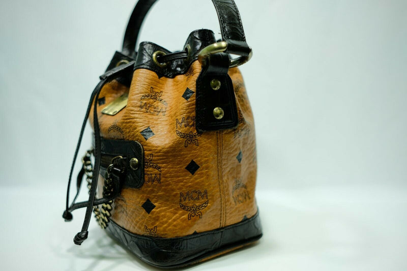 Pre-loved authentic Mcm Cognac Visetos Drawstring sale at jebwa