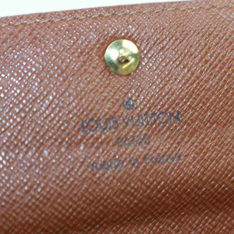 Pre-loved authentic Louis Vuitton Pochette Monnaie Long sale at jebwa