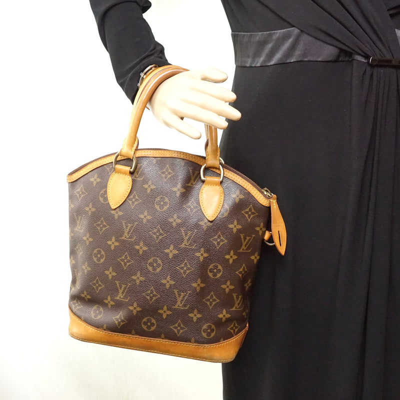 Pre-loved authentic Louis Vuitton Lock It Hand Bag sale at jebwa.
