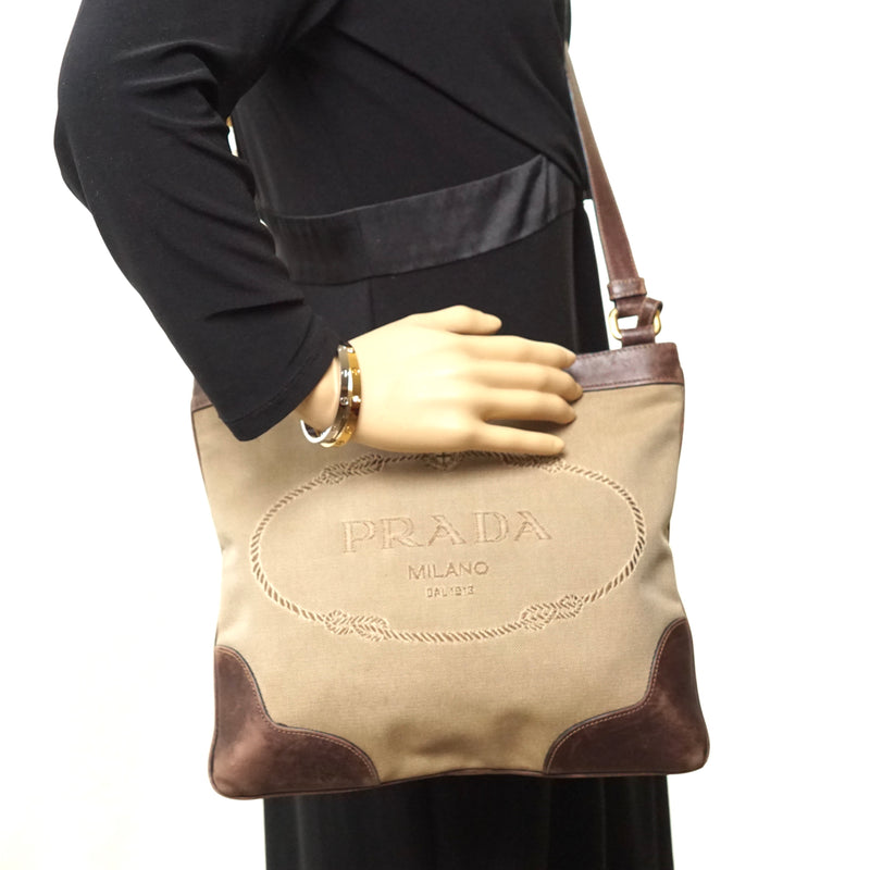 Pre-loved authentic Prada Crossbody Bag Brown Canvas sale at jebwa