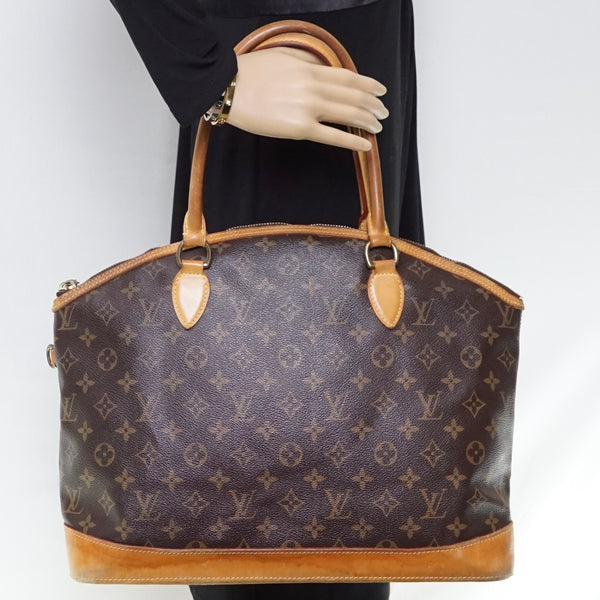 Pre-loved authentic Louis Vuitton Lockit Tote Bag Brown sale at jebwa.