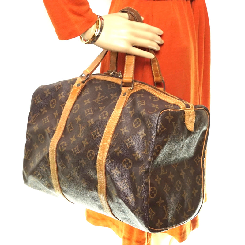Pre-loved authentic Louis Vuitton Sac Souple 55 Travel sale at jebwa