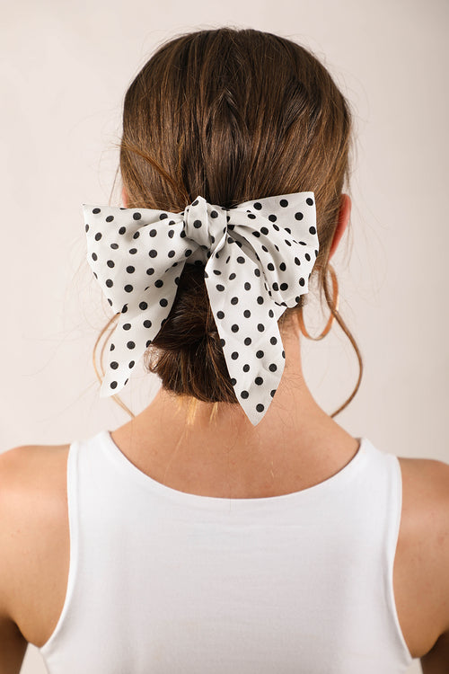 white and black spotty scrunchie