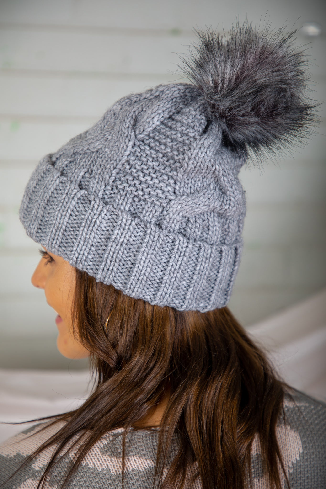 grey beanie with pom pom