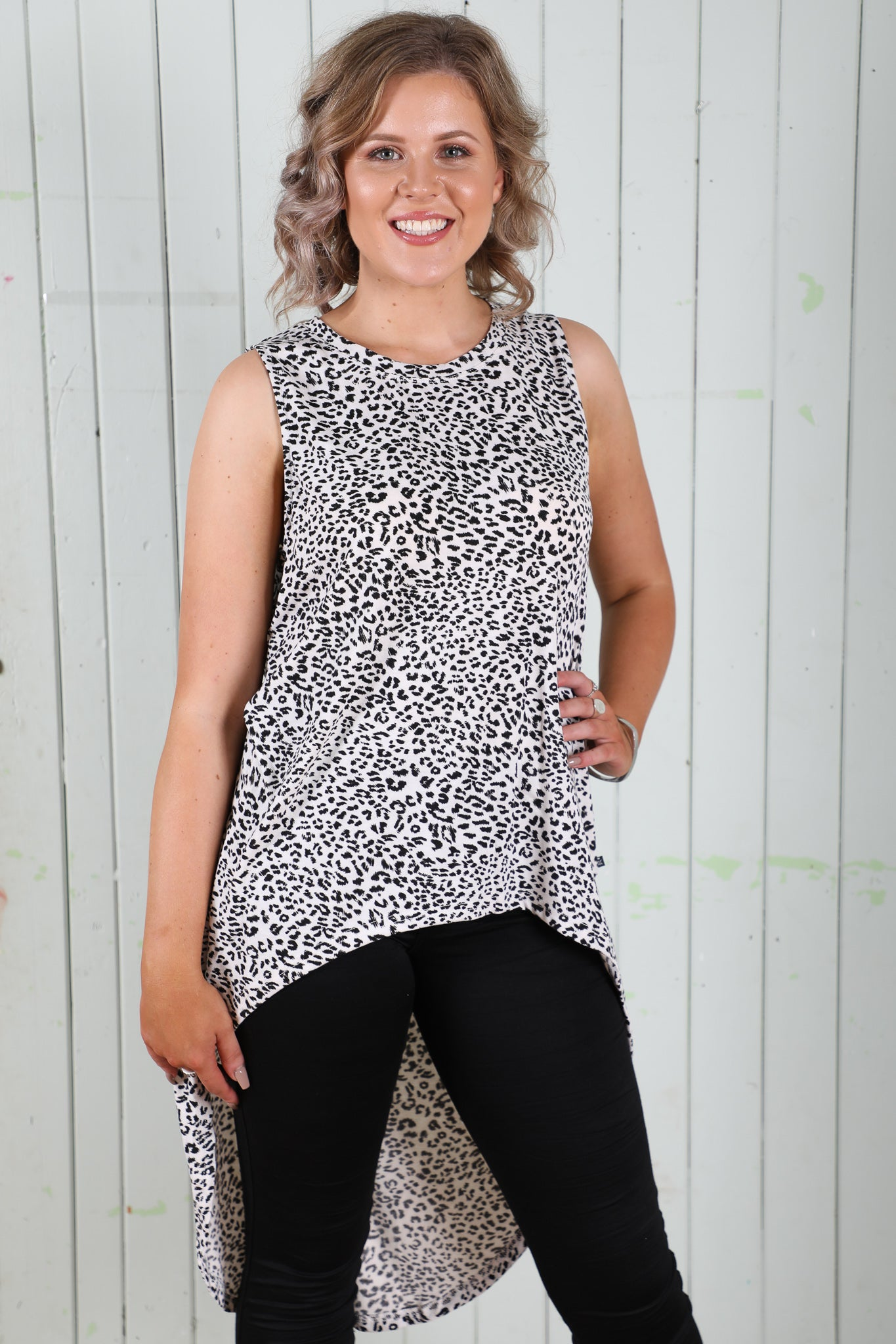 refuge white and black leopard print hi lo top