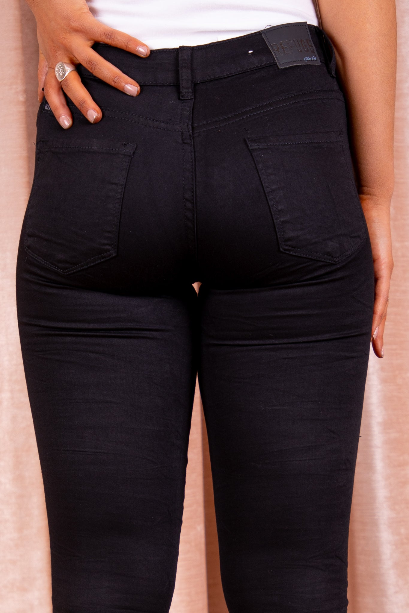 black ripped knee refuge denim jeans