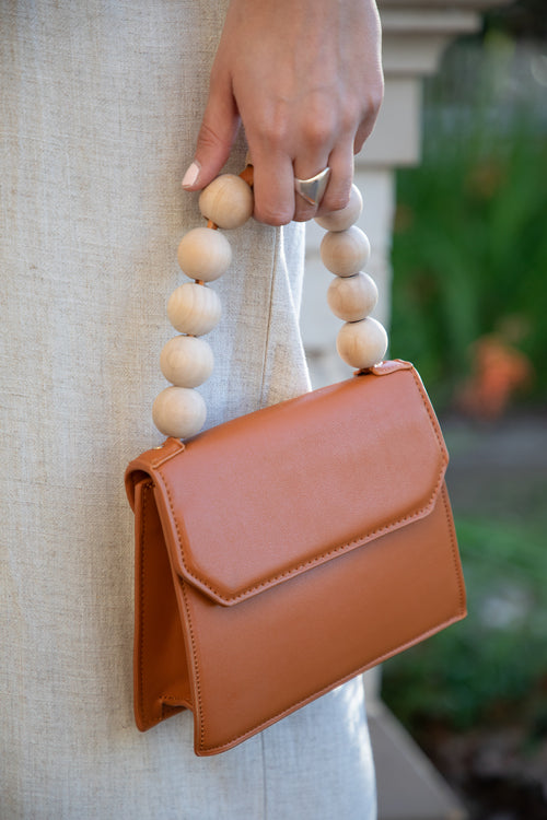 tan handbag beaded strap